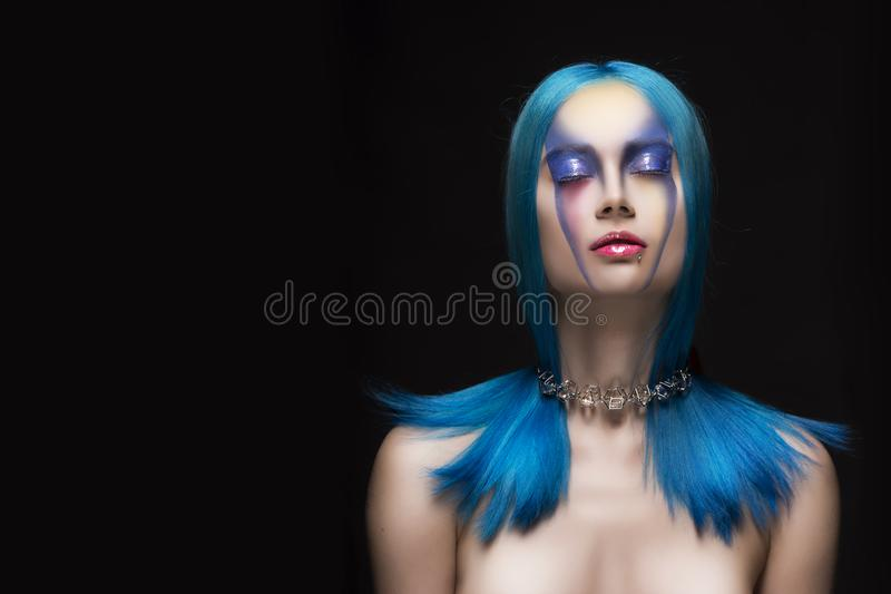 Sensual portrait of beautiful dyed blue hair naked shoulders closed eyes girl wearing necklace. Vanguard fashion make-up. Copy space. Hairdressing salon stock photo