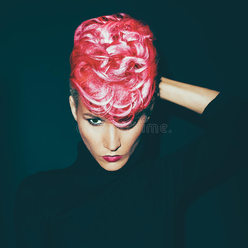 Sensual portrait lady with fashionable haircut colored hair on a. Black background stock images
