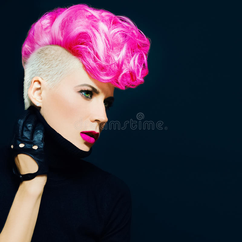 Sensual portrait lady with fashionable haircut colored hair on a. Black background stock photos