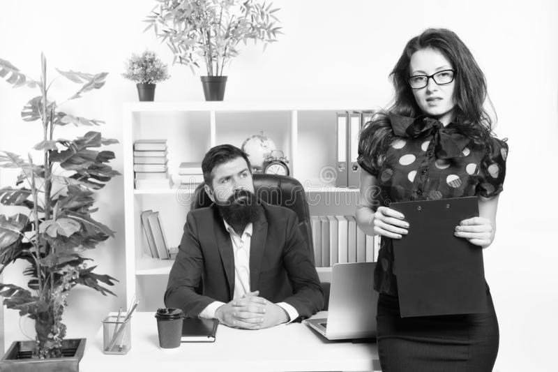 Sensual but professional. Sensual business lady. Sensual woman standing in front of businessmen in office. Adorable girl royalty free stock images