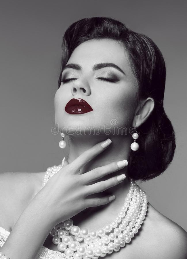Sensual red lips. Elegant passion retro woman portrait with fashion jewelry set. Black and white vintage photo. stock photography