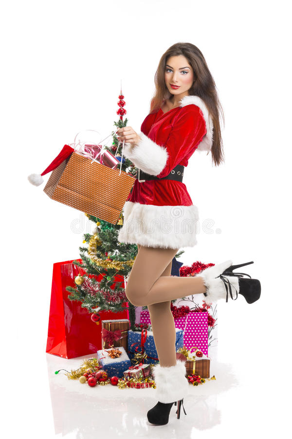 Sensual Santa girl with presents stock image