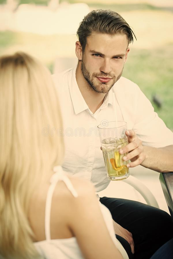 Sensual woman. Romantic young couple drink at table in restaurant. Or cafe outdoor, flirting, enjoying, relaxing conversation royalty free stock photo