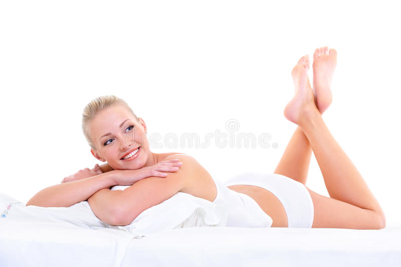 Sensual smiling woman lying on the  bed