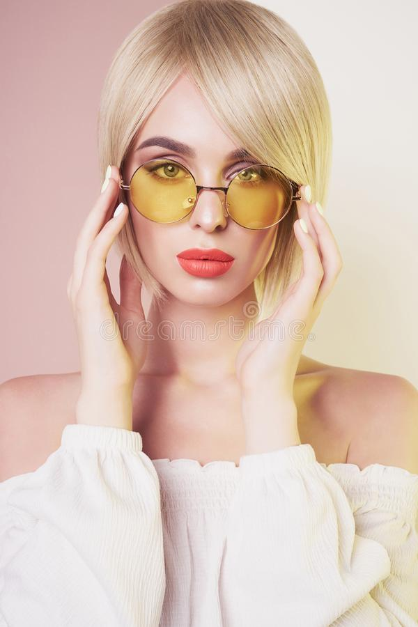 Sensual stylish woman in erotic white dress. Blue-eyed lady with perfect lips in modern colour sunglasses. Beautiful sexy blonde with professional classic make stock photos