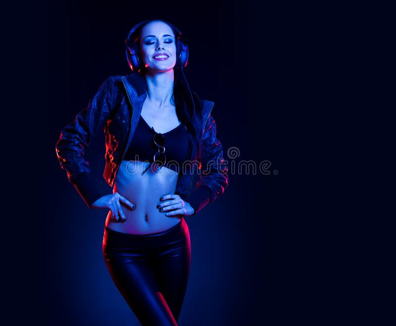 Sensual techno dancer. Sensual techno dancer woman in colorful club lighting royalty free stock photo