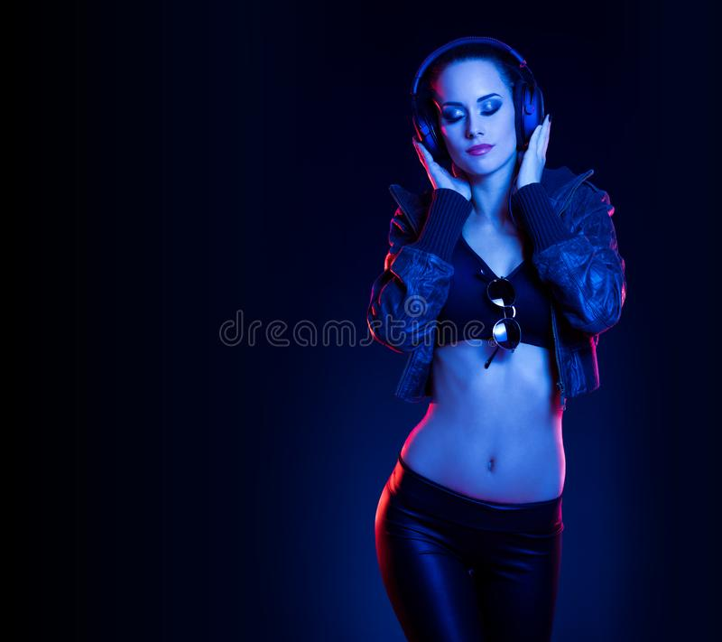 Sensual techno dancer. Sensual techno dancer woman in colorful club lighting royalty free stock image