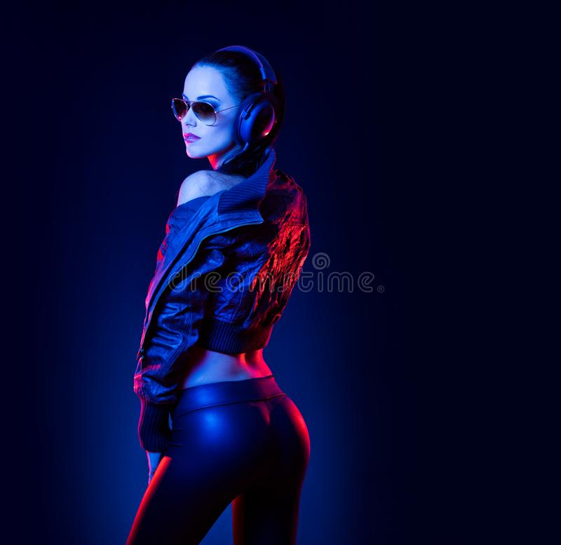Sensual techno dancer. Sensual techno dancer woman in colorful club lighting stock photo