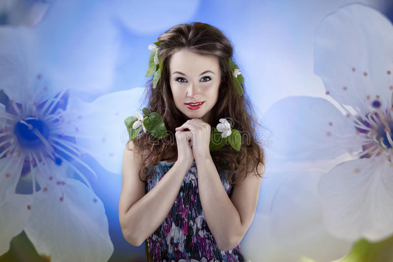 Sensual woman behind an artistic background from two flowers. Studio shot royalty free stock photos