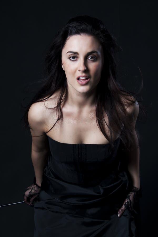 Sensual woman in black on black background
