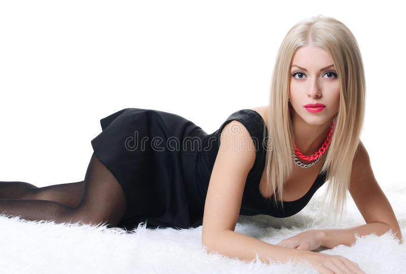 Sensual woman in a black dress on a carpet stock images