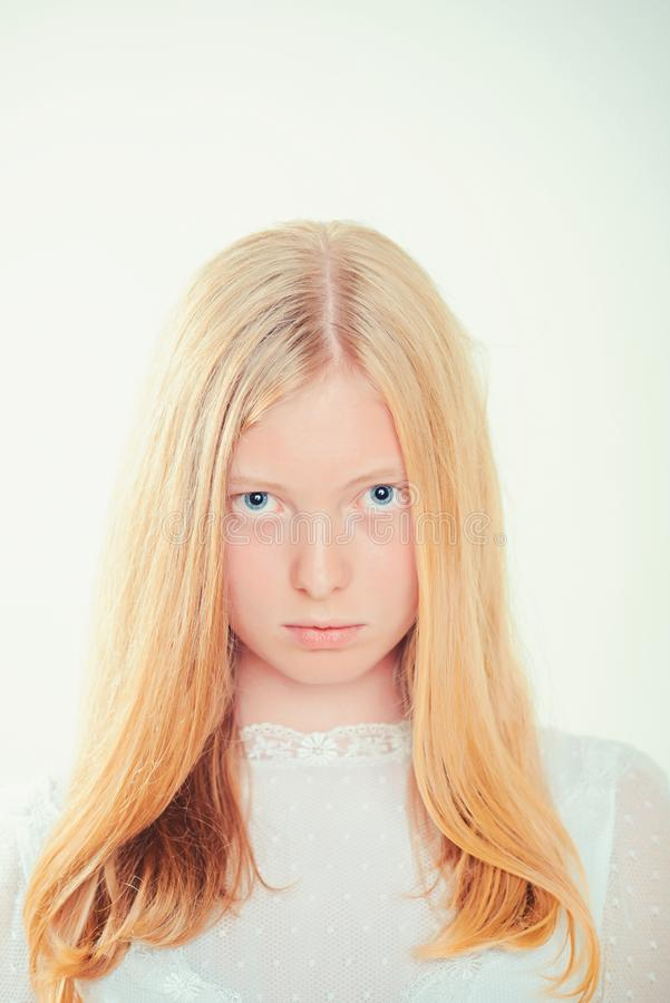 Sensual woman with blond long hair. Woman with natural beauty look and no makeup. Albino girl with blue eyes and white royalty free stock photo