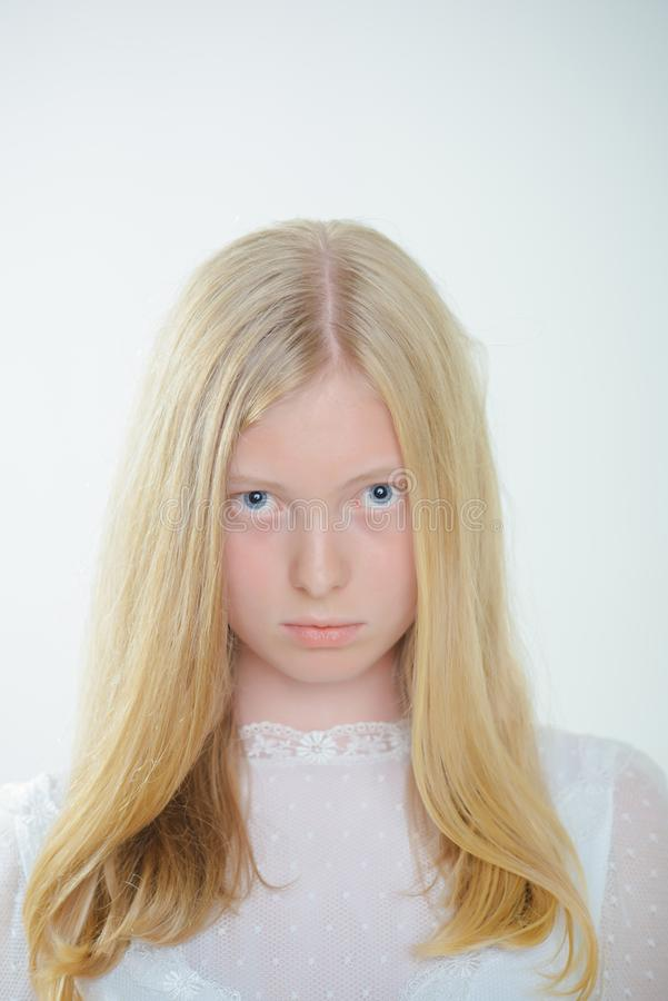 Sensual woman with blond long hair. Woman with natural beauty look and no makeup. Albino girl with blue eyes and white stock images