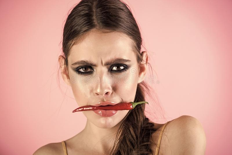 Sensual woman body. Girl with spice fruit and serious face royalty free stock photos