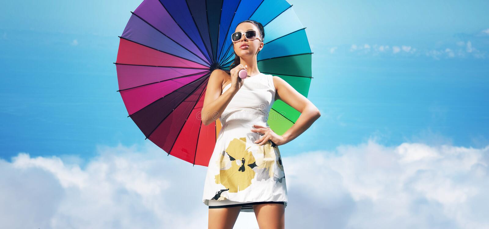 Sensual woman with the colorful umbrella royalty free stock photo