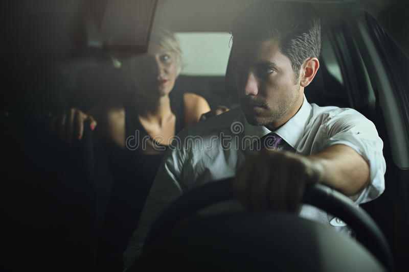 Sensual woman and driver on a car royalty free stock image
