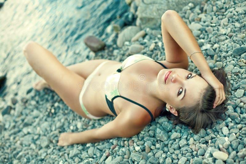 Sensual woman enjoying sunny day on tropical beach royalty free stock photography