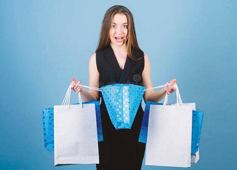 Sensual woman hold purchase package. shopping bag. Big sales. sexy woman with long hair at shopping. fashion and beauty royalty free stock photography