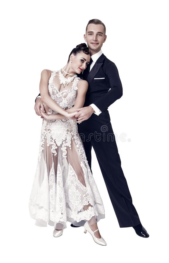 Sensual woman and man dance. Bride in white dress and groom in tuxedo. Couple of ballroom dancers in love. Valentines. Sensual women and men dance. Bride in stock photography