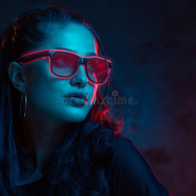 Sensual woman in neon glasses portrait royalty free stock image