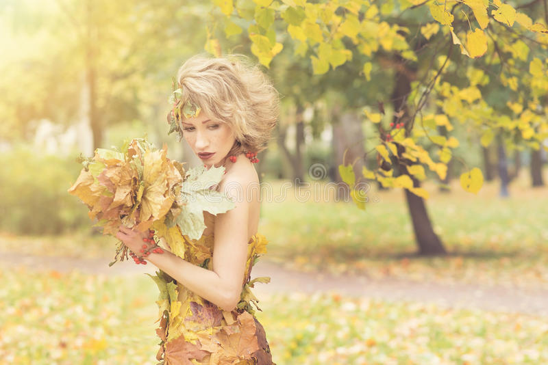 Sensual woman in park at autumn. Model stock photography