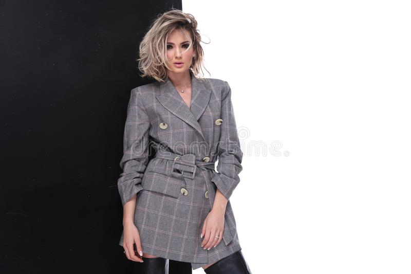 Sensual woman with parted lips wearing grey plaid suit jacket. While standing on black and white background, portrait picture royalty free stock images