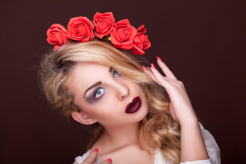 Sensual woman professional make up flowers in head. Studio lighting stock photos