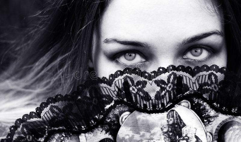 Download Sensual Woman With Seductive Eyes Behind Fan Stock Photo - Image: 8549628