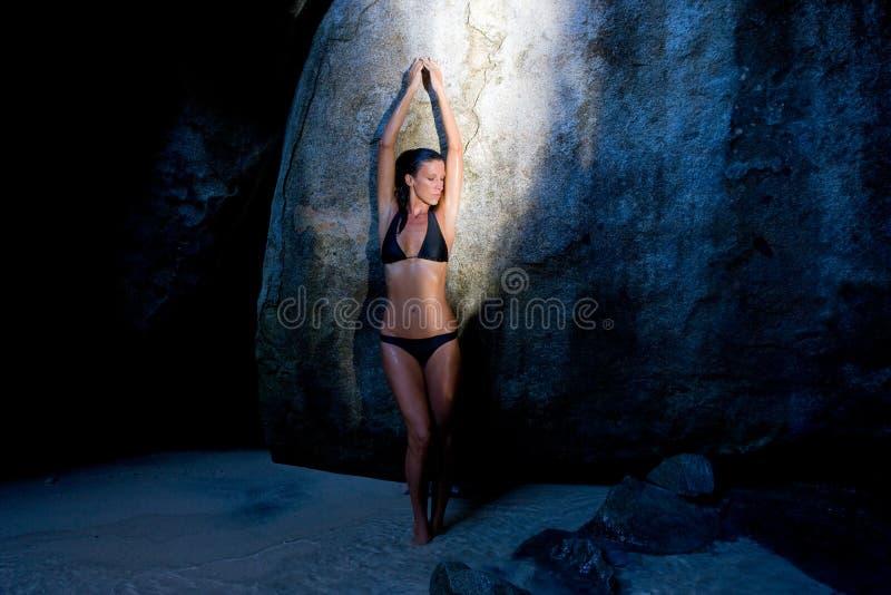 Sensual woman tropical resort cave royalty free stock image
