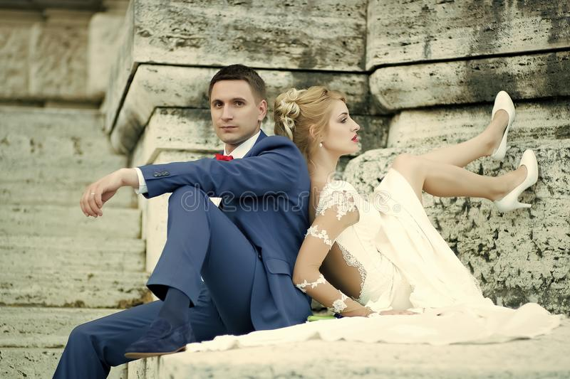 Sensual young couple making love. Wedding pair sitting outdoor royalty free stock photos