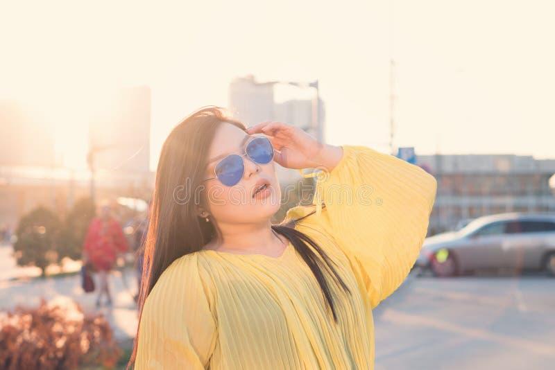 Stylish Pan-Asian girl posing outdoor stock photography