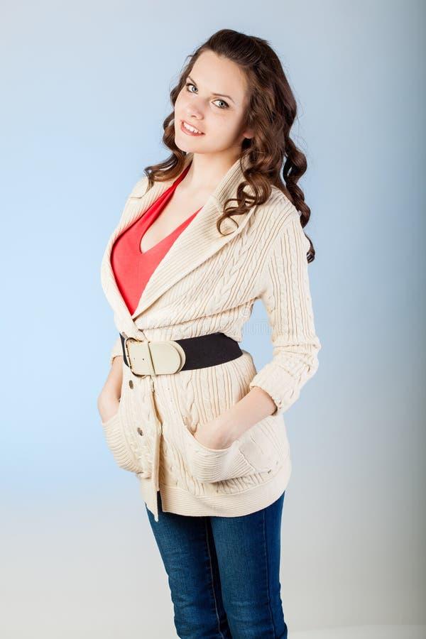 Sensual young woman with beautiful long brown hairs. Studio shot royalty free stock image