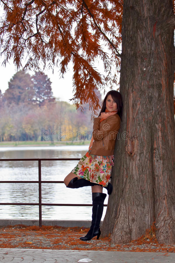 Sensual young woman waiting in park royalty free stock photography