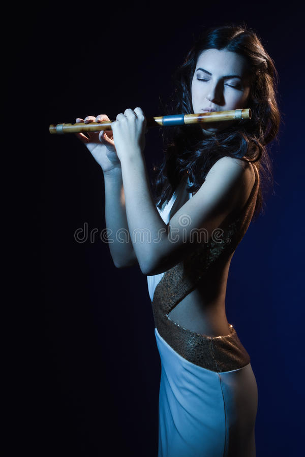 Download Sensuality Brunette Plays A Wooden Flute Stock Photo - Image: 33475936