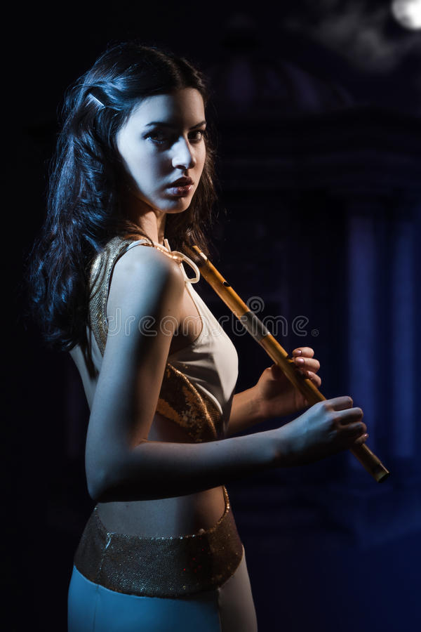 Download Sensuality Brunette With A Wooden Flute Stock Image - Image: 33475951
