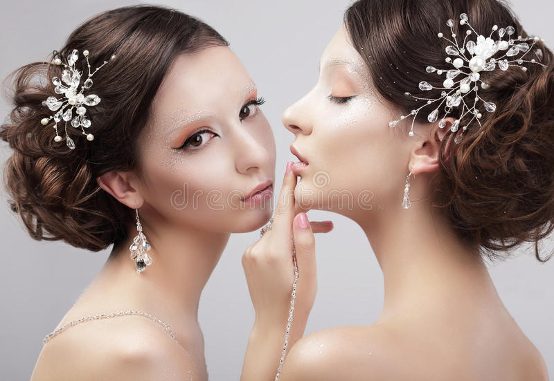 Sensuality. Two Women Fashion Models with Trendy Make-up stock photos