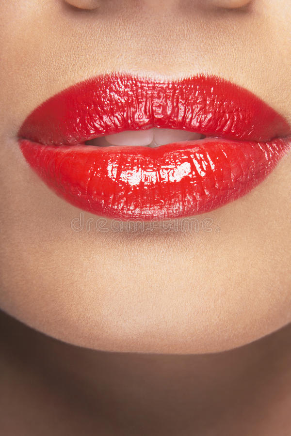 Sensuous Woman Wearing Red Lipstick. Closeup of sensuous woman wearing red lipstick royalty free stock image