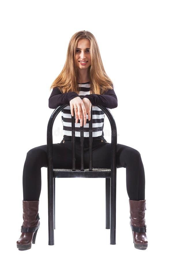 Sentada de la mujer imagen de archivo