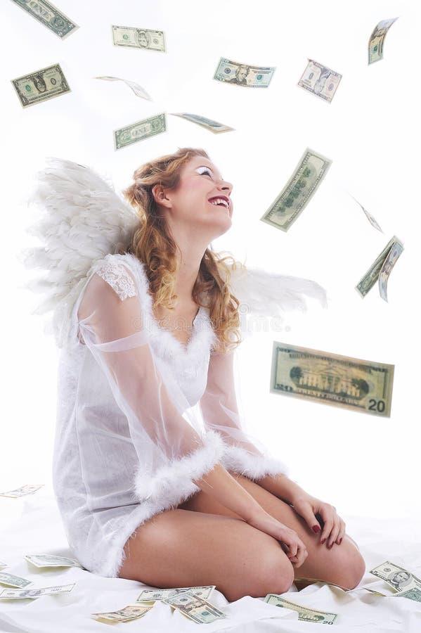 Sentada del ángel, el llover del dinero fotografía de archivo