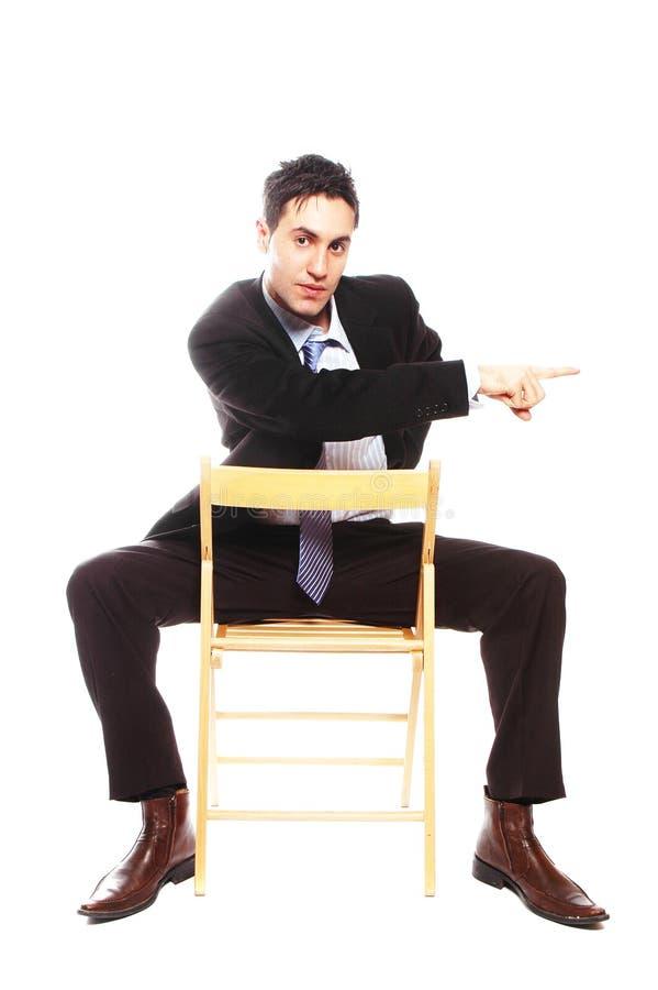 Sentada del hombre de negocios imagen de archivo