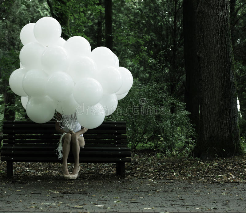 Download Sentimentality. Nostalgia. Lonely Woman With Air Balloons Sitting On Bench In The Park Stock Photo - Image of birthday, latex: 33396070