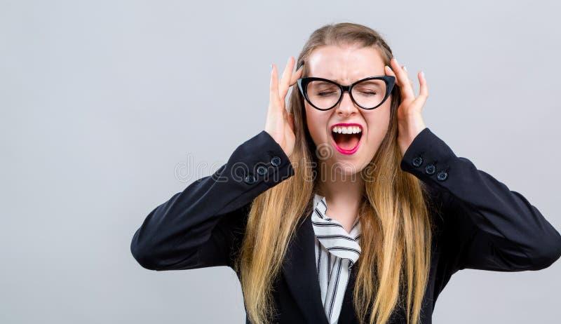 Sentimento da jovem mulher forçado imagens de stock royalty free