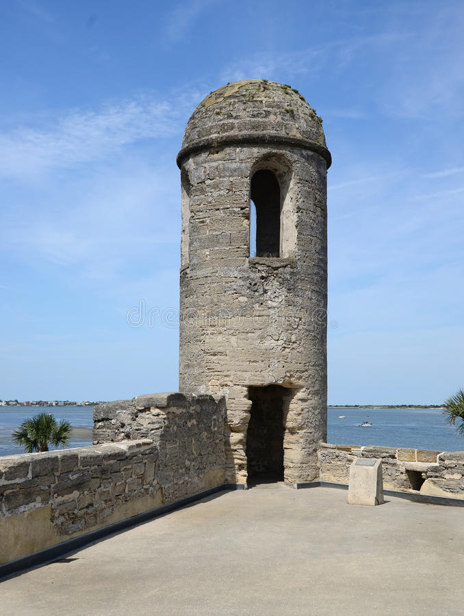 A sentry watch tower in St Augustine Fort. The strong defensive fort in St Augustine looks out over the water. The fort was built to defend against sea attacks stock photos