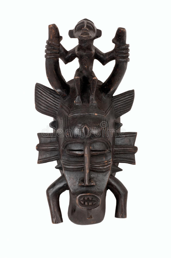 Senufo African mask. Senufo mask from West Africa, carved in wood; small splits, scrapes and cracks attest to its age/use stock photography