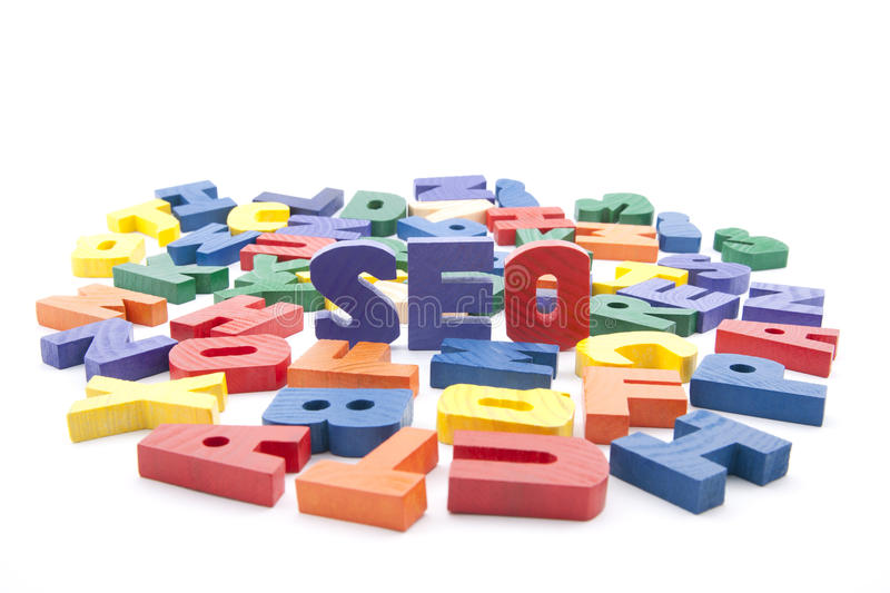Seo. The word seo written with colorful wooden letters isolated on white stock photography