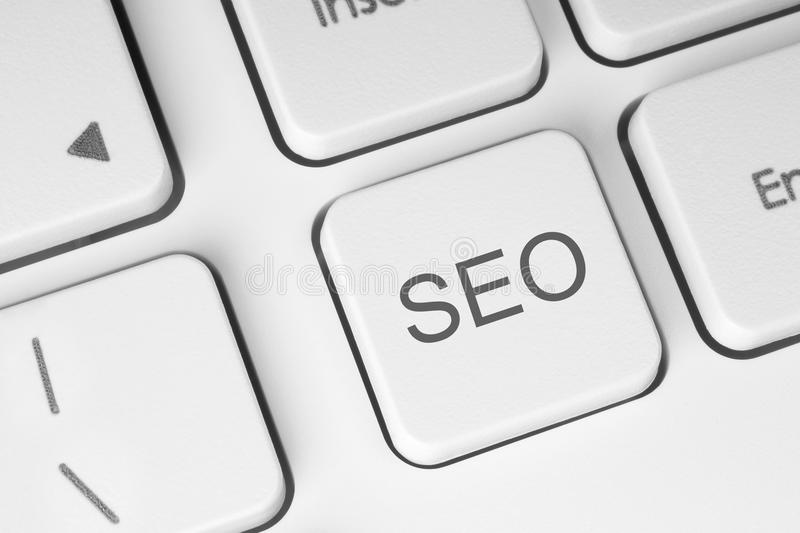 SEO button on the keyboard royalty free stock image