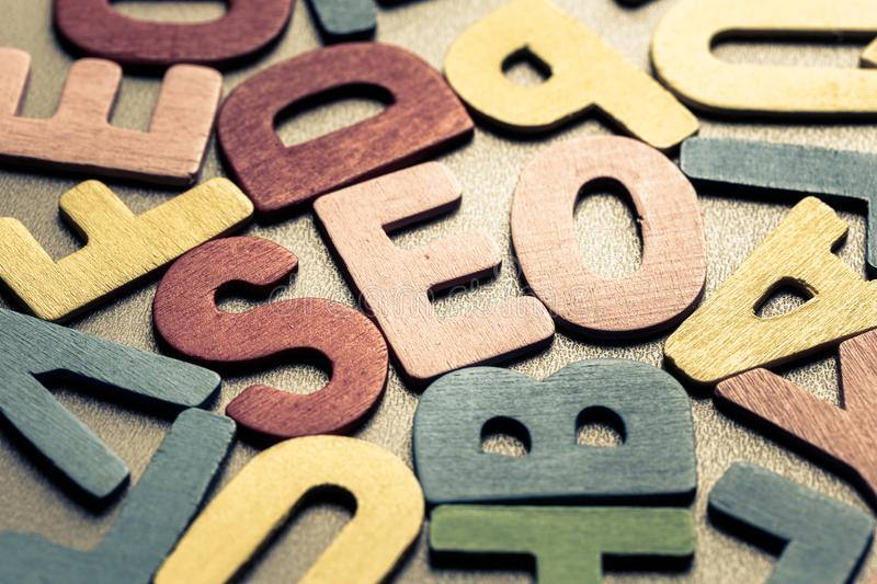 SEO. Closeup SEO in scattered wood letters stock images