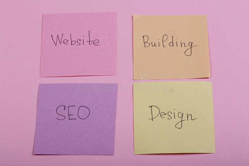 Seo concept - colorful sticky notes with words design, website, seo, building on pink background. Blog, branding, business, competition, computer, create stock image