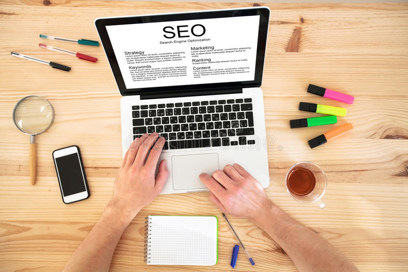 SEO concept on the screen of laptop royalty free stock images