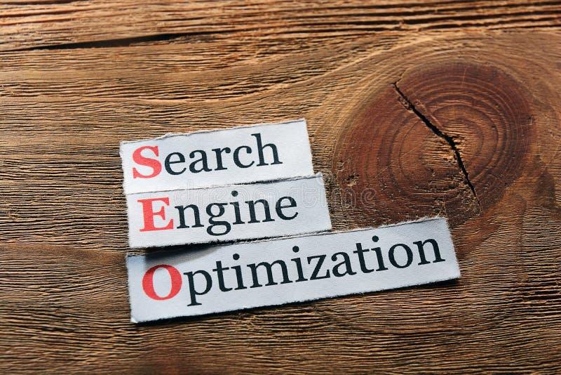 SEO. Conceptual SEO acronym on wood - Search Engine Optimization stock image